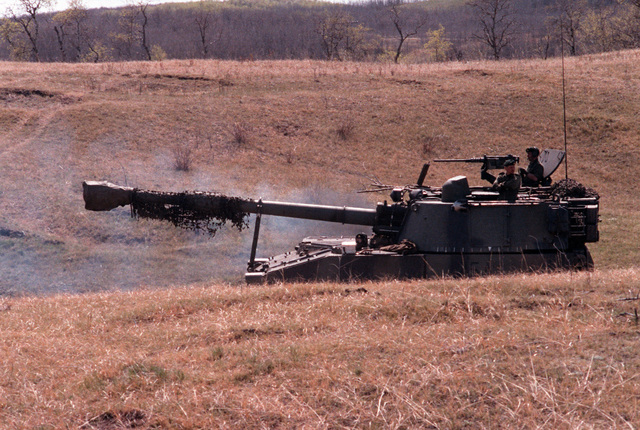 A Canadian army M-109A1 155 mm self-propelled howitzer moves into firing position during the combined United States/Canadian NATO exercise RENDEZVOUS '83