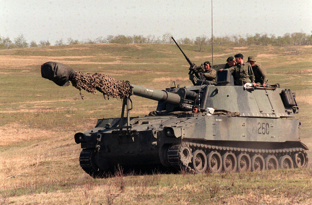 A Canadian Army M-109A1 155mm self-propelled howitzer moves out after completing a firing mission during the combined U.S./Canadian NATO Exercise Rendezvous /83