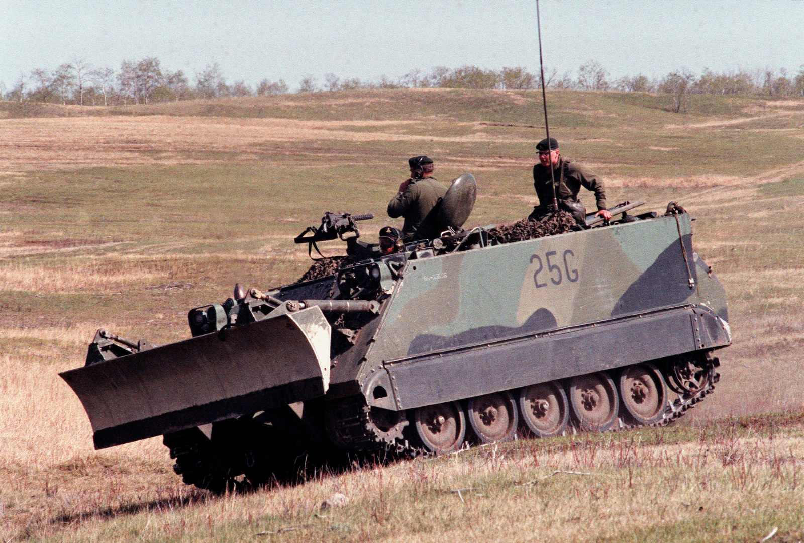 A Canadian army M-113A1 armored personnel carrier, equipped with a bulldozer blade, in use during the combined United States/Canadian NATO exercise RENDEZVOUS '83