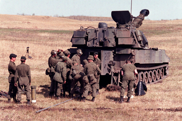 Canadian soldiers receive an explanation of the functions of the M-109A1 155 mm self-propelled howitzer during the combined United States/Canadian NATO exercise RENDEZVOUS '83