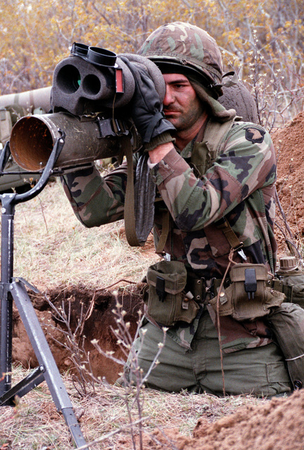 Private Tim Lindley, Company B, 3rd Battalion, 327th Infantry, 101st Airborne Division, looks through the sights of his Dragon medium anti-tank weapon during the combined United States/Canadian NATO exercise RENDEZVOUS '83