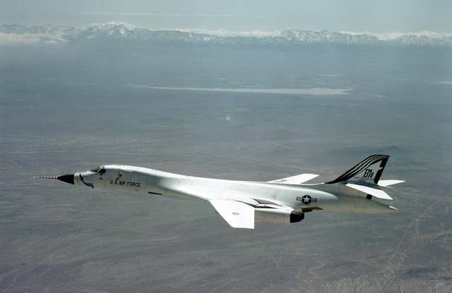 An air-to-air left side view of a B-1B bomber aircraft