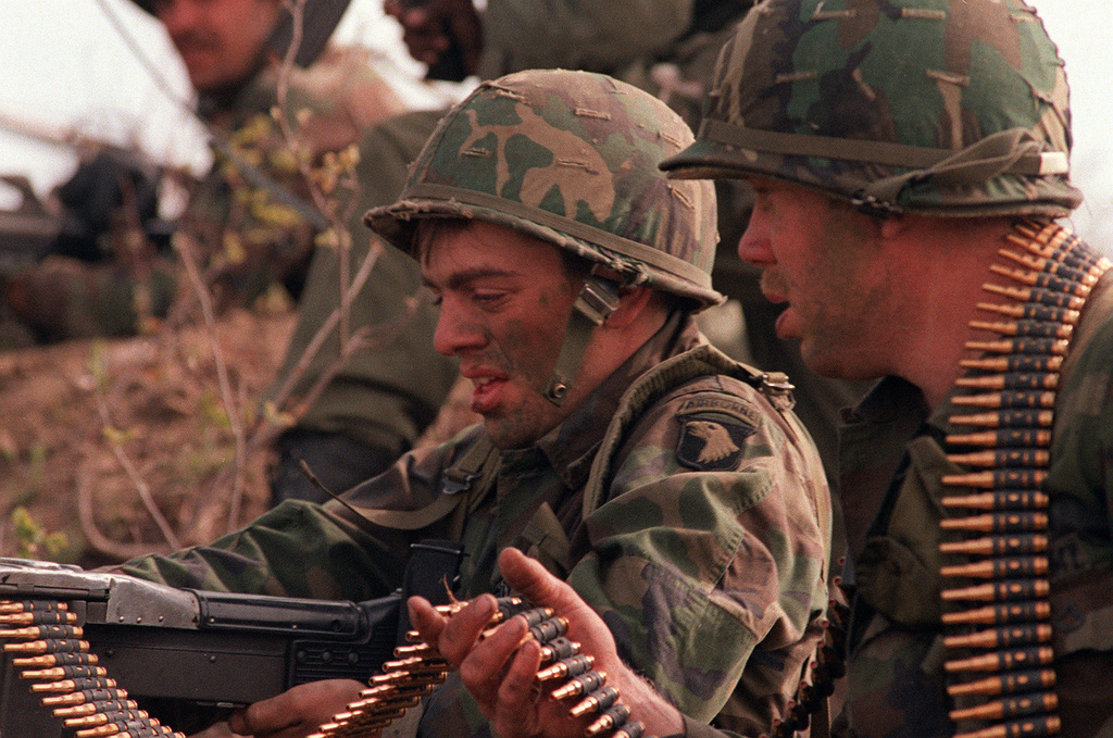 An M-60 machine gun crew from the 3rd Bn., 327th Inf., 101st Abn. Div., defends its position from a mock attack by members of the Canadian Army during the combined U.S./Canadian NATO Exercise Rendezvous '83