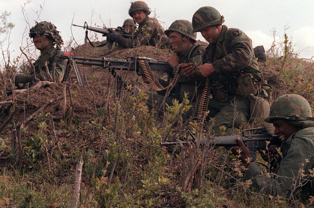 Members of the 3rd Bn., 327th Inf., 101st Abn. Div. defend their position with an M-60 machine gun and M-16 rifles during a mock attack by members of the Canadian Army. They are participating in the combined U.S./Canadian NATO Exercise Rendezvous '83