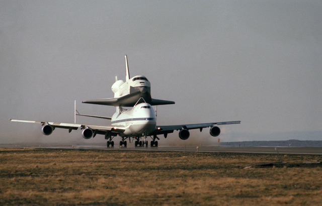 A specially-prepared NASA 747 aircraft carrying the space shuttle Enterprise takes off after a stopover at the air station