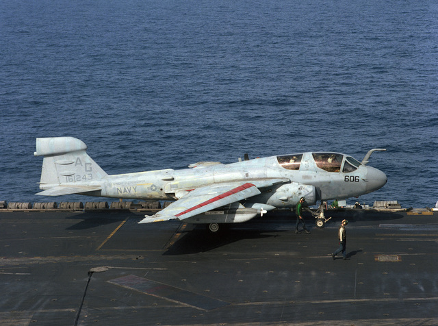 A catapult crewman and plane director stand by as an EA-6B Prowler aircraft is positioned on a catapult aboard the nuclear-powered aircraft carrier USS DWIGHT D. EISENHOWER (CVN 69)