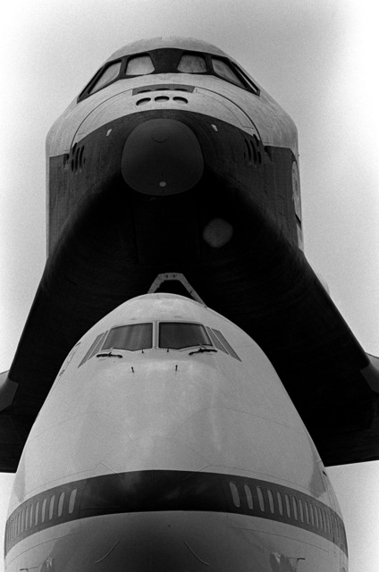 A close-up front view of the space shuttle orbiter Enterprise and its specially modified 747 transport aircraft on display at the airport