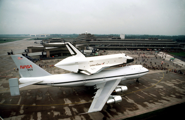 A right side view of the space shuttle orbiter Enterprise and its specially modified 747 transport aircraft on public display at Koln-Bonn Airport. The Enterprise is at the airport for five days prior to the Paris Air Show