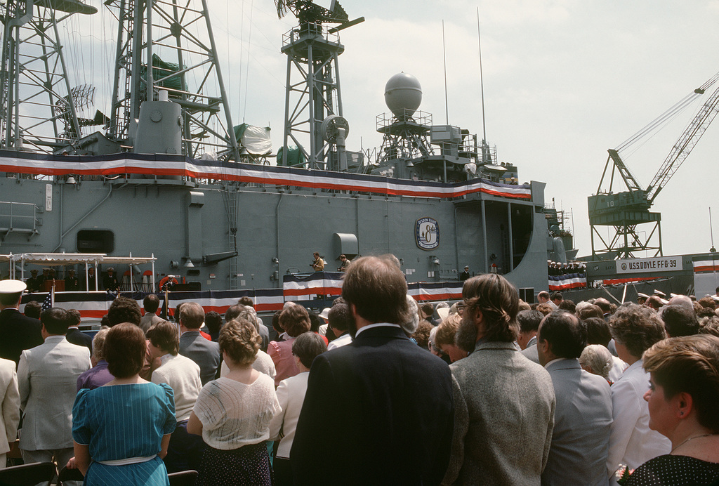 Guests stand during the commissioning of the guided missile frigate USS DOYLE (FFG 39)