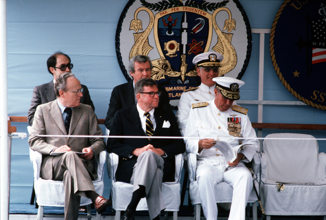 Members of the official party listen as the Rev Joseph N. Green, vice mayor of Norfolk, gives the invocation at the commissioning ceremony for the nuclear-powered attack submarine USS NORFOLK (SSN-714)