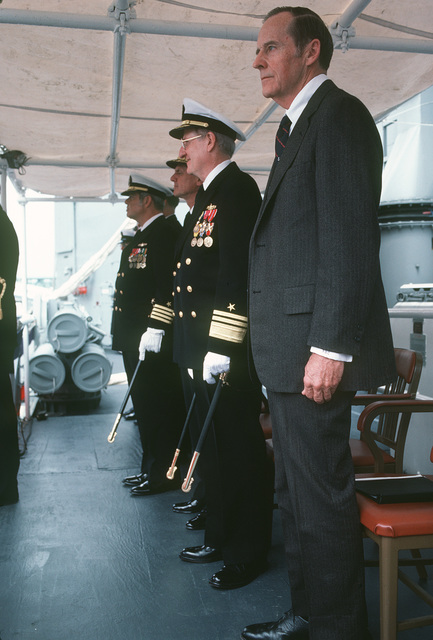 Standing on the speakers platform during the commissioning of the guided missile frigate USS DOYLE (FFG 39) are, right to left, Robert H. Conn, deputy undersecretary of the Navy, Financial Management, right, and retired Vice Admiral (VADM) James H. Doyle; VADM Edward S. Briggs, commander Naval Surface Force; and Captain (CAPT) Michael P. Kalleres, commander Destroyer Squadron Eight
