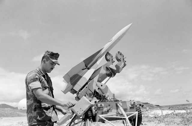 Lance Corporal Martinaz, assigned to Battery C, checks a Hawk surface-to-air missile being used in support of Operation KERNAL BLITZ