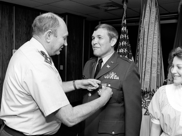 Lieutenant General Richard G. Trefry, Inspector General, Headquarters, US Army, presents the Legion of Merit to Lieutenant Colonel John P. Coppens, an inspector general within the Office of the Inspector General during a ceremony held at the Pentagon