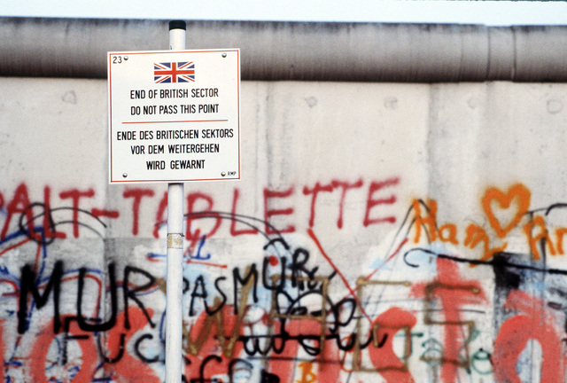 """A sign indicates where the British sector ends at """"The Wall,"""" separating communist-controlled East Germany from West Germany"""