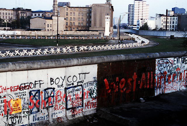 """A view of """"The Wall,"""" which separates communist-controlled East Germany from West Germany. Graffiti marks the West Berlin side while the East side remains spotless"""