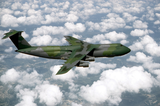 An air-to-air right side view of a 22nd Military Airlift Squadron C-5A Galaxy aircraft returning to Travis Air Force Base, Calif., after being painted in the European camouflage pattern at the San Antonio Air Logistics Center, Kelly Air Force Base, Texas