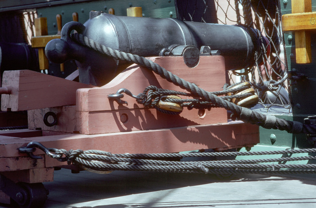 One of the sights aboard the sailing frigate USS CONSTITUTION is the 32-pound smooth bore cannonade on the spar deck. These guns required a crew of four to nine men to operate. PHOTO from June 1983 All Hands Magazine