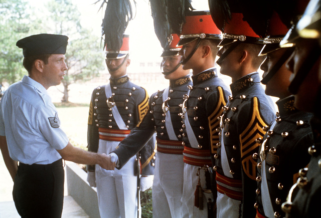 MASTER Sergeant Thomas Merrick, Outstanding AIRMAN of the Year, congratulates senior class leaders at the Philippines Military Academy on an excellent parade