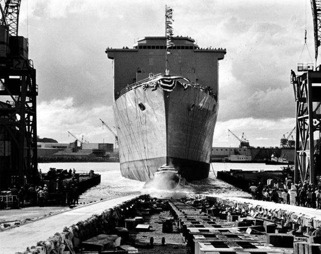 A bow view of the dock landing ship WHIDBEY ISLAND (LSD-41) as it slides down the ways into the Duwamish River during its launching ceremony