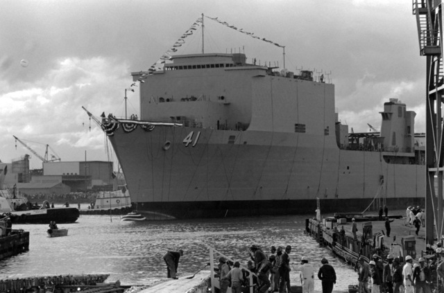 A port bow view of the dock landing ship WHIDBEY ISLAND (LSD 41) just after being launched during a ceremony at the Lockheed Shipyard