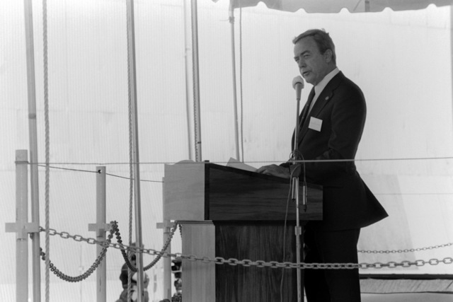 Lawrence Kitchen, the president and chief operating officer of the Lockheed Corporation, addresses guest and spectators attending the launching ceremony for the dock landing ship WHIDBEY ISALAND (LSD 41) at the Lockheed Shipyard