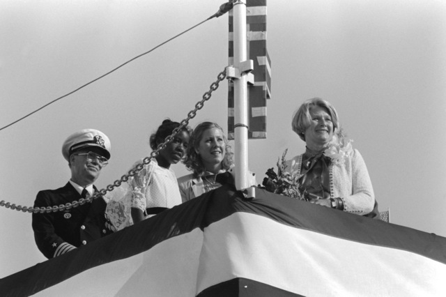 Observing the launching of the dock landing ship WHIDBEY ISLAND (LSD 41) are, from left to right, Captain Phillip F. Carothers, Diedre Kelly, Sarah Gorton and Sally Gorton, wife of Sen. Slade Gorton, R-Washington