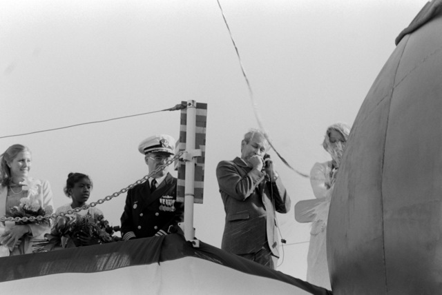 Sally Gorton, wife of Sen. Slade Gorton, R-Washington, christens the dock landing ship WHIDBEY ISLAND (LSD 41) during the ship's launching ceremony at the Lockheed Shipyard. Observing are, left to right, Sarah Gorton, Diedre Kelly and Captain Phillip F. Carothers