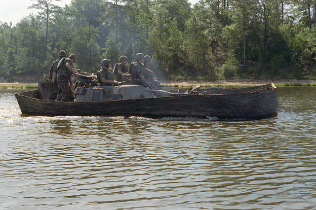 Infantrymen learn to operate an M2 Bradley Infantry Fighting Vehicle in the water. This amphibious vehicle is propelled in the water by its tracks
