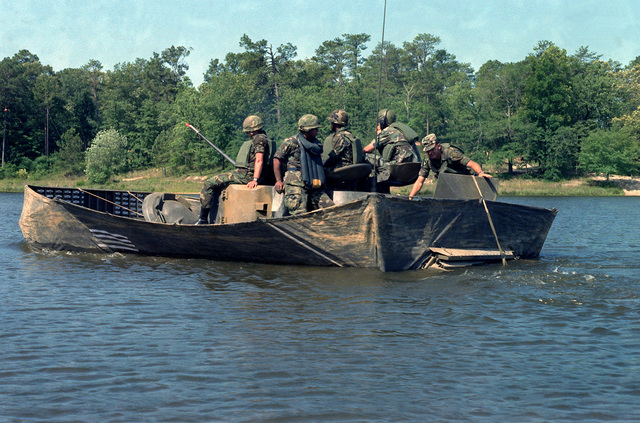 Infantrymen train in water combat operations in an M2 Bradley Infantry Fighting Vehicle at Victory Pond. This amphibious vehicle is propelled in the water by its tracks