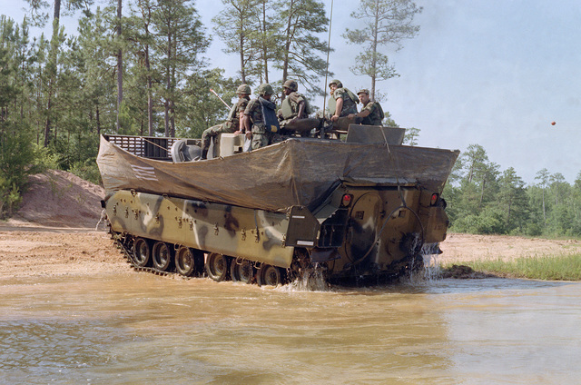 Rear view of an M2 Bradley Infantry Fighting Vehicle exiting the water at Victory Pond. This amphibious vehicle is propelled in the water by its tracks