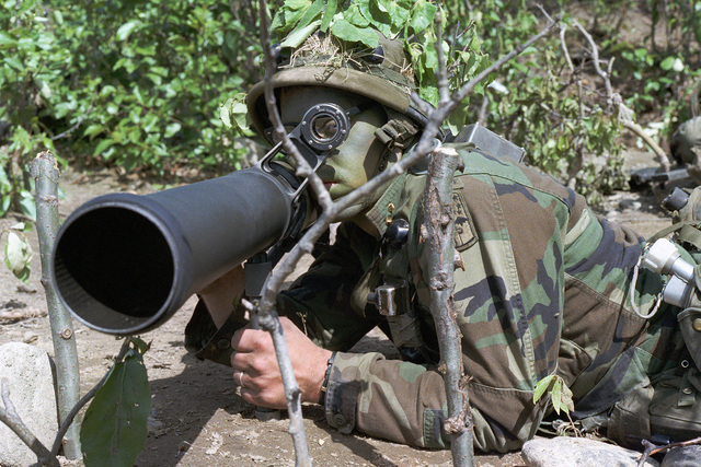 SPECIALIST Fourth Class (SPC) Chris Denning, Company C, 4th Battalion, 327th Infantry Brigade, positions a 90 mm M67 recoilless rifle for firing during Exercise LASER STRIKE 83