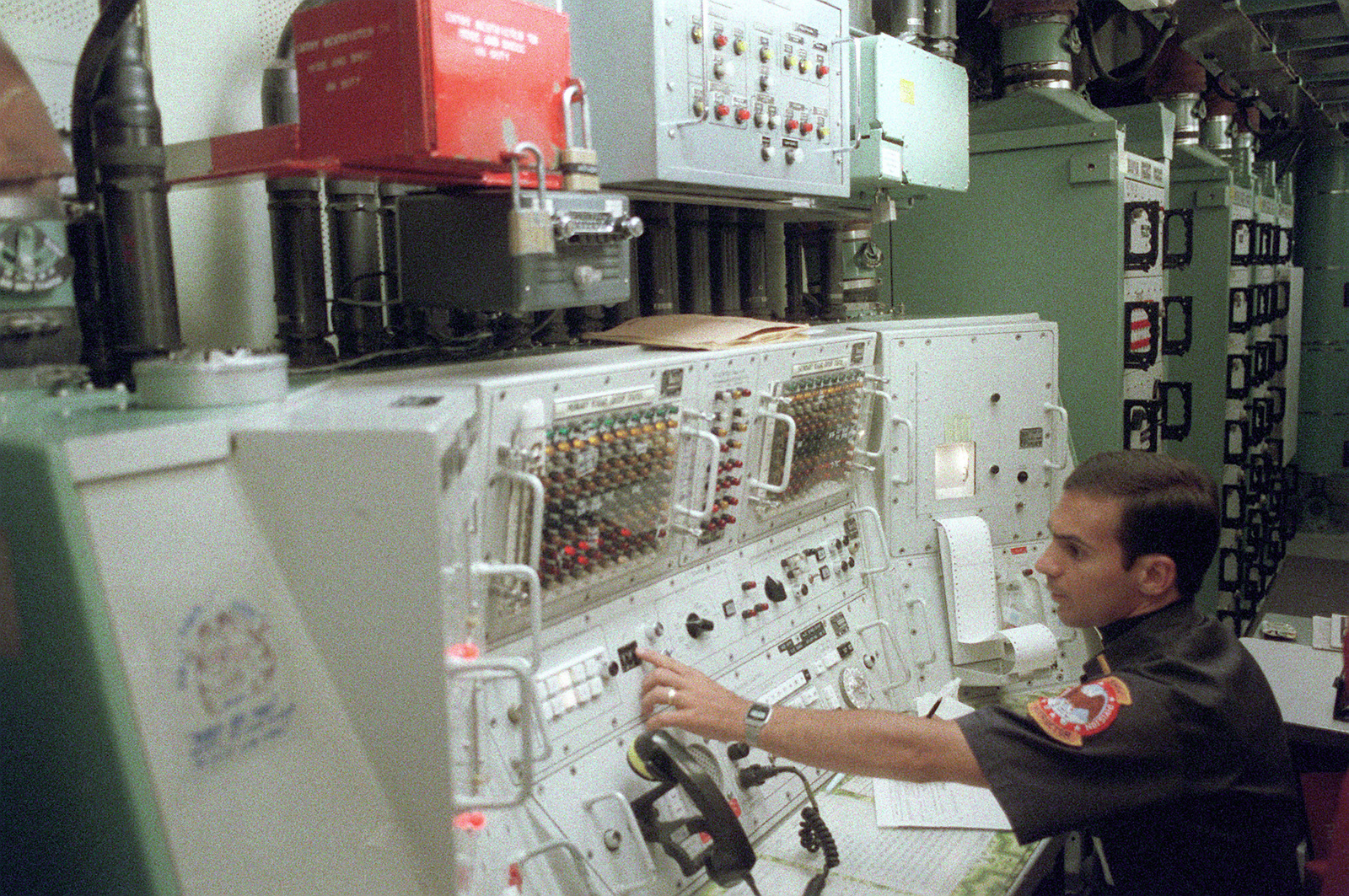 A member of the 321st Strategic Missile Wing works at a control panel inside a Minuteman III intercontinental ballistic missile silo