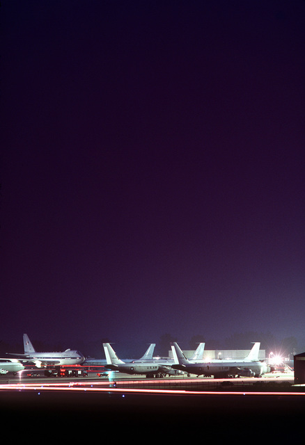 A nighttime view of Strategic Air Command (SAC) aircraft on the flight line during exercise Global Shield. To the far left is an E-4 advanced airborne command post aircraft and to the far right, an EC-135 APOLLO/range instrumentation aircraft (A/RIA)