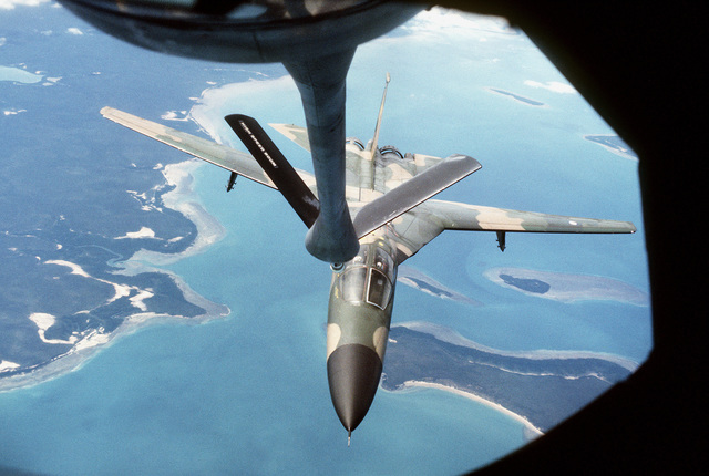 A view from a KC-135 Stratotanker aircraft boom operator's window of an F-111 aircraft as it approaches the refueling boom of the KC-135 during Exercise Pitch Black '83-1