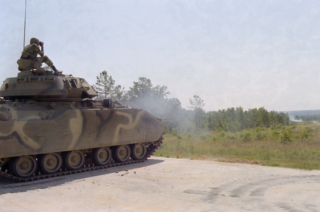 Infantrymen fire the M242 25 mm Chain Gun of an M2 Bradley Infantry Fighting Vehicle during qualification tests on a firing range