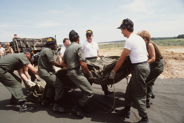 Members of the 37th Aeromedical Evacuation Group prepare to erect a tent during Exercise WOUNDED EAGLE '83. The exercise is designed to test the Civilian-Military Contingency Hospital System, a program for transferring wartime casualties to civilian hospitals in the event they overflow military facilities