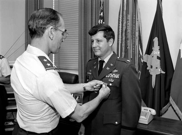 Major General Robert B. Solomon, Deputy Inspector General, presents the Legion of Merit to Lieutenant Colonel Gene N. Cartier, CHIEF of the Automation Management Branch, Office of the Inspector General, Headquarters, Department of the Army. Ceremony held at the Pentagon