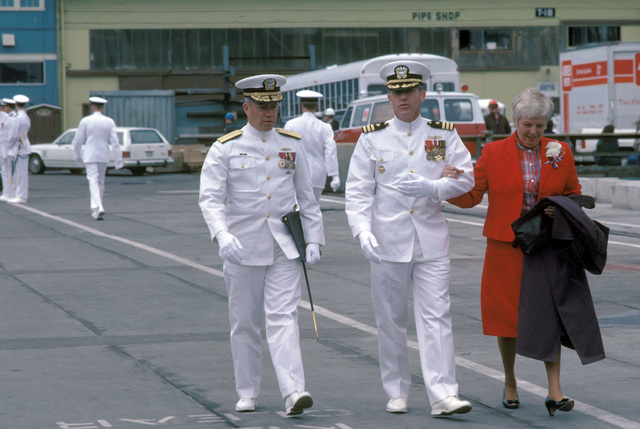 Commodore (CDMR) Theodore E. Lewin, commander, Naval Base, Seattle, and his wife are escorted to their seats by Commander (CDR) James W. Orvis, commanding officer, prior to the start of the commissioning ceremony for the Oliver Hazard Perry class guided missile frigate USS CROMMELIN (FFG 37)