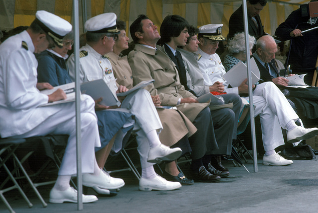 Distinguished guests are seated on the speakers platform during the commissioning of the Oliver Hazard Perry class guided missile frigate USS CROMMELIN (FFG 37). Commodore (CMDR) Theodore E. Lewin, commander, Naval Base, Seattle, is seated third from right