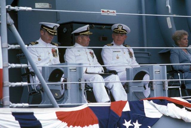 Left to right: Commander (CDR) James W. Orvis, commanding officer; Commodore (CMDR) Theodore E. Lewin, commander, Naval Base Seattle; Captain (CAPT) Thomas Head, commander, Destroyer Squadron Nine; and Mrs. Richard B. Meyers, ships sponsor, are seated on the speakers platform during the commissioning of the Oliver Hazard Perry class guided missile frigate USS CROMMELIN (FFG 37)