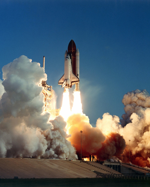 The space shuttle orbiter Challenger lifts off from Complex 39A at 7:33 a.m. EDT. Aboard the seventh flight of the Space Transportation System (STS-7) are: Bob Crippen, commander; Frederick H. Hauck, pilot; and mission specialists Sally Ride, John Fabian and Dr. Norman Thagard