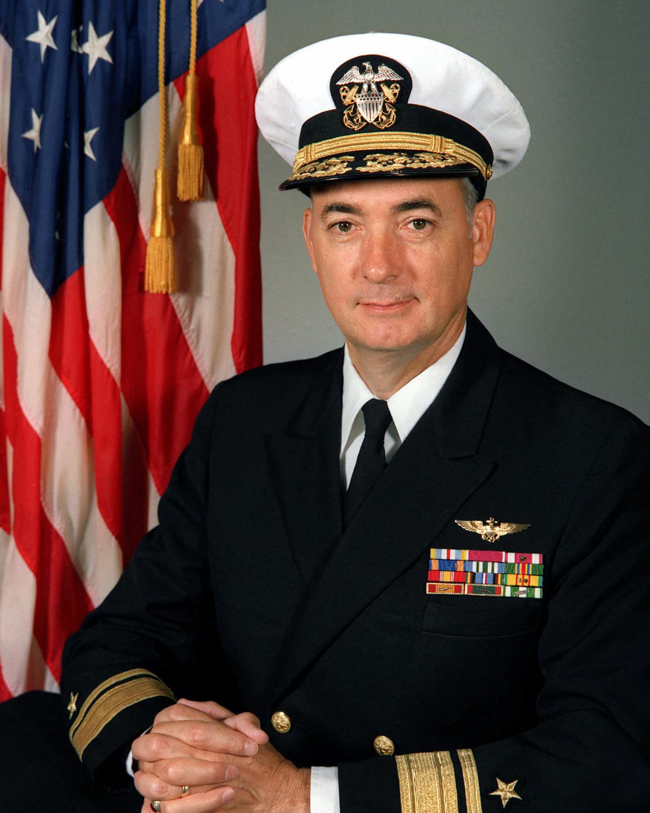RADM (upper half) Ronald E. Narmi, USN (covered)