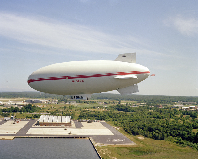 A left side view of Skytrain 500, a 164-foot British-built airship, during a flight near the center. The Naval Air Development Center is sponsoring the test project to determine if airships offer a practical, military value to the Navy. NATC is evaluating the airship's flying qualities, performance, and vulnerability to radar