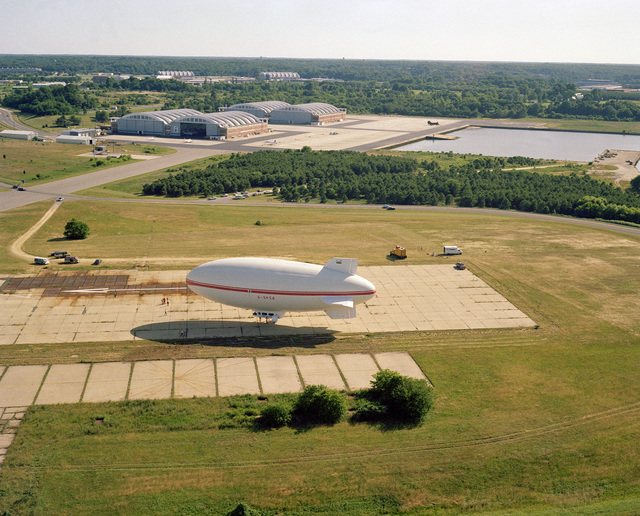 A left side view of Skytrain 500, a 164-foot British-built airship undergoing tests at the center. The Naval Air Development Center is sponsoring the test project to determine if airships offer a practical military value to the Navy. NATC is evaluating the airship's flying qualities, performance, and vulnerability to radar