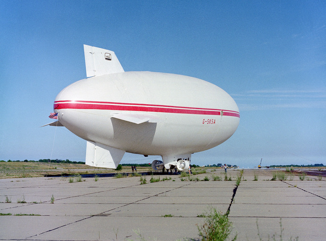 A right rear view of Skytrain 500, a 164-foot British-built airship undergoing tests at the center. The Naval Air Development Center is sponsoring the test project to determine if airships offer a practical military value to the Navy. NATC is evaluating the airship's flying qualities, performance, and vulnerability to radar