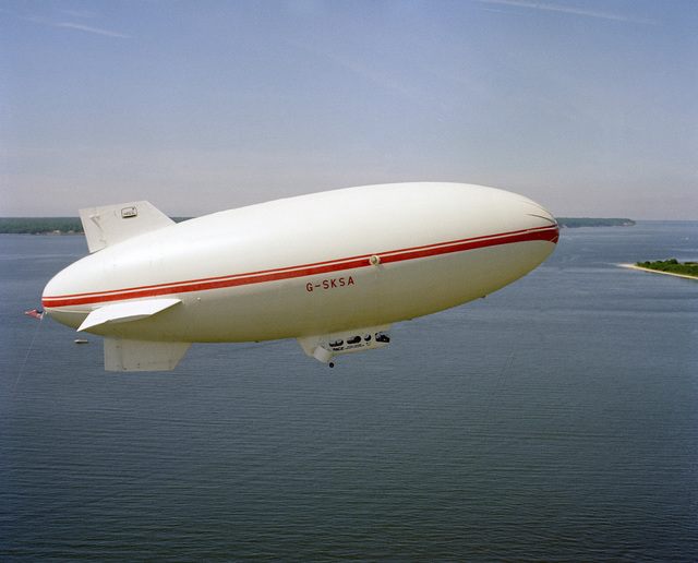 A right side view of Skytrain 500, a 164-foot British-built airship, during a flight near the center. The Naval Air Development Center is sponsoring the test project to determine if airships offer a practical, military value to the Navy. NATC is evaluating the airship's flying qualities, performance, and vulnerability to radar