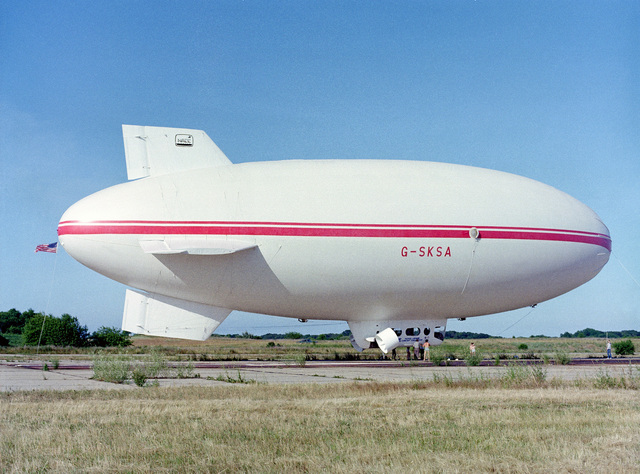 A right side view of Skytrain 500, a 164-foot British-built airship undergoing tests at the center. The Naval Air Development Center is sponsoring the test project to determine if airships offer a practical, military value to the Navy. NATC is evaluating the airship's flying qualities, performance, and vulnerability to radar