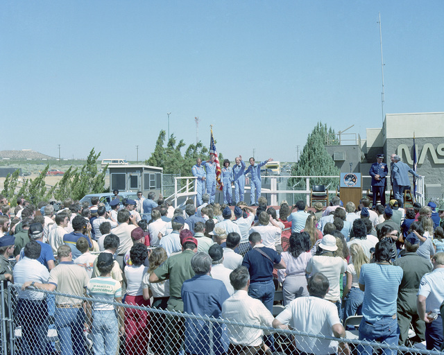 Space shuttle Challenger astronauts greet well-wishers upon their return from space after completing Space Transportation System Mission 7 (STS-7). On the platform are, from left to right, Mission Specialists Dr. Norman Thagard, John Fabian and Dr. Sally Ride; Frederick Hauck, pilot, and Robert Crippen commander. Ride is the first American woman astronaut to fly in space