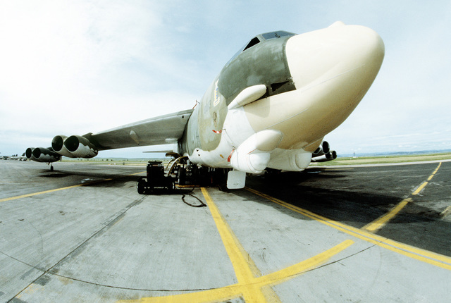 A wide-angle right front view of a B-52H Stratofortress aircraft being serviced on the flight line during Strategic Air Command exercise Global Shield '83