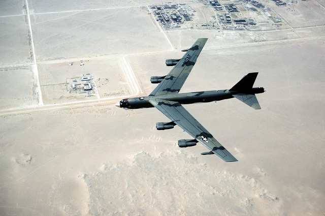 A U.S. Air Force B-52 Stratofortress bomber seen from above as it flies over the desert near Cairo, Egypt during BRIGHT STAR '83, the joint U.S. and Egyptian military training exercise. Exact Date Shot Unknown